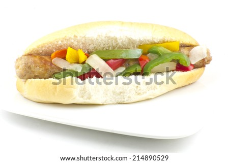 Fried sausage onions and red, green, and yellow bell peppers on sandwich bun - stock photo