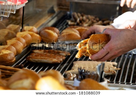 Fried Sausages (Bratwurst) being sold in a vending Stall in Germany.  - stock photo