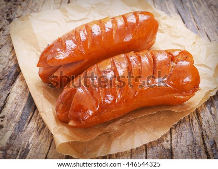 fried sausages on wooden background