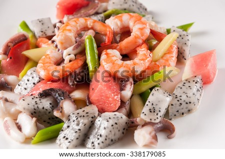 Fried seafood and fruit - stock photo