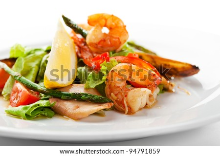 Fried Seafood Salad with Lemon Slice and Asparagus - stock photo
