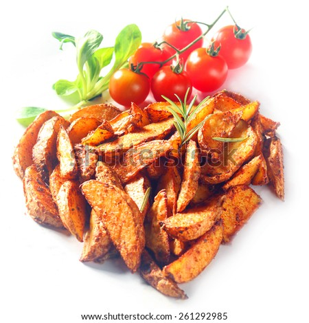 Fried Seasoned Potato Wedges with Cherry Tomatoes on Vine and Fresh Basil Herbs on White Background - stock photo