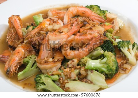 fried shrimp and broccoli on white plate
