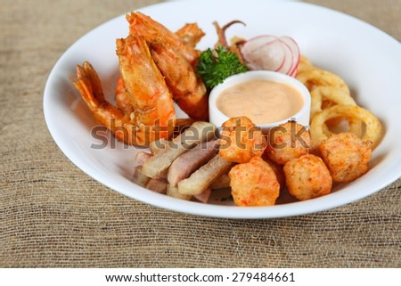 fried shrimp and squid served with mayonnaise sauce. - stock photo
