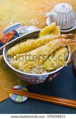 Fried shrimp in a bowl of white rice. - stock photo