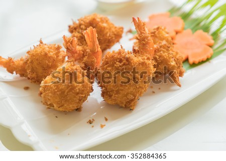 fried shrimp with cheese on table