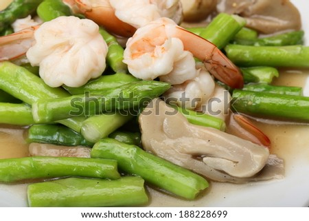 Fried shrimp with vegetable on white dish
