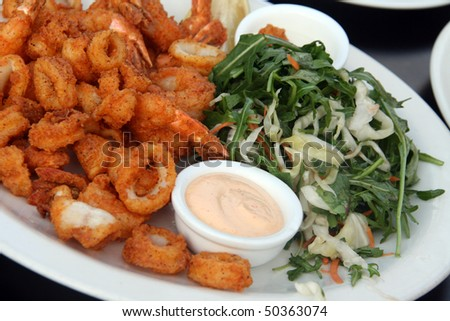 Fried Shrimps and calamary with salad
