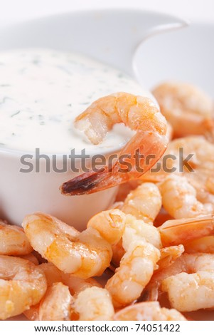 Fried shrimps on a plate and sauce - stock photo