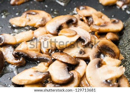 fried sliced mushrooms - stock photo