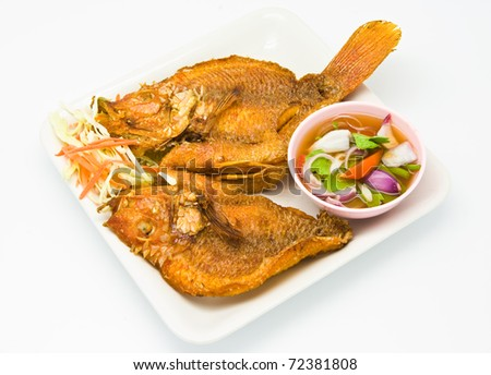 Fried snapper with chili sauce on the plate - stock photo