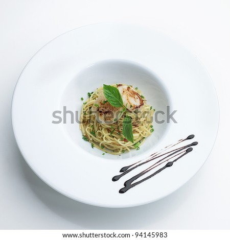Fried spaghetti  seafood menu with  scallops cooking with seasoning  garnish isolated on white - stock photo