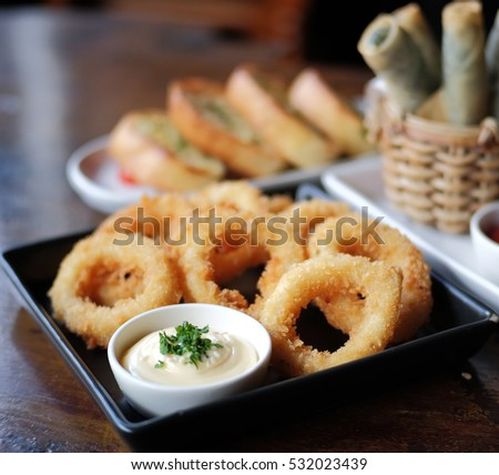 fried squid in black plate