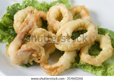 Fried squid rings isolated - stock photo