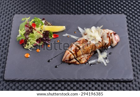 Fried squid stuffed with wild mushrooms  - stock photo
