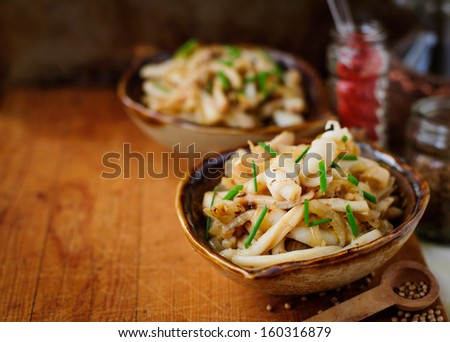 Fried Squid with Onions and Chives, vintage effect, copy space for your text - stock photo