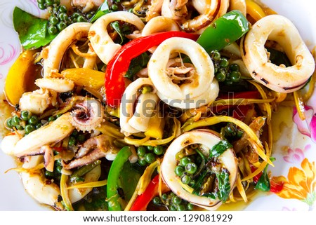 Fried squid with spicy herbs - stock photo