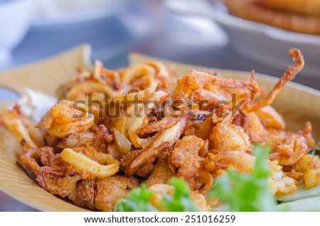 fried squids and garlic served with vegetable on  dish - stock photo
