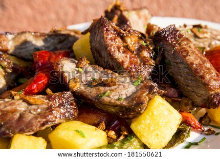 Fried steak in pieces with chips and pepper - stock photo