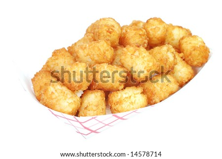 Fried tater tots in basket.  Isolated on white background. - stock photo