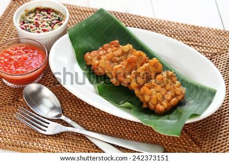 fried tempeh, indonesian food, vegetarian food, soybean product, tempeh goreng - stock photo