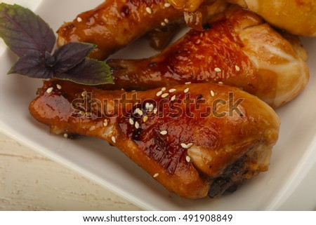 Fried Teriyaki chicken legs with sesame seeds