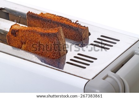 Fried toast in the toaster  isolated on white background - stock photo