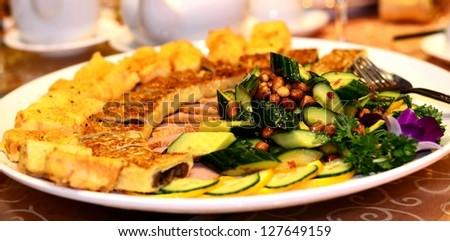 Fried tofu and cucumber dish - stock photo
