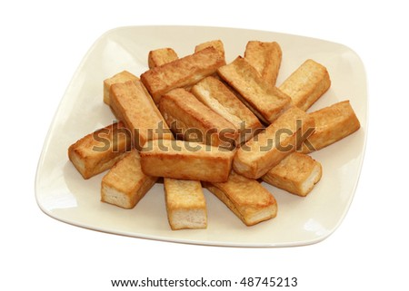 Fried tofu on dish isolated on white background - stock photo