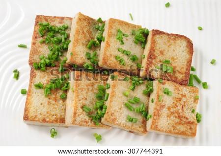 Fried tofu with onion - stock photo
