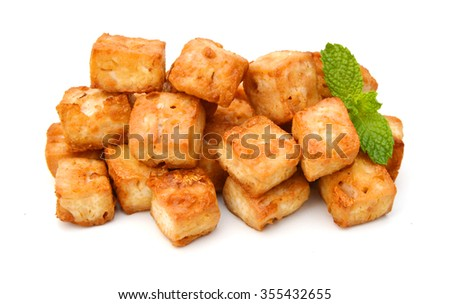fried tofu with parsley on white background