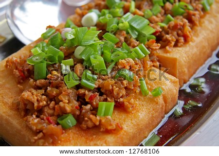 Fried tofu with sauce traditional chinese cuisine - stock photo