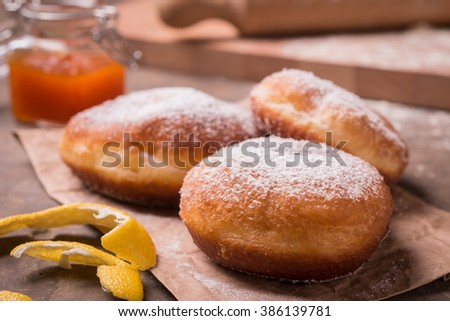 Fried traditional Krapfen donuts on still life composition - stock photo