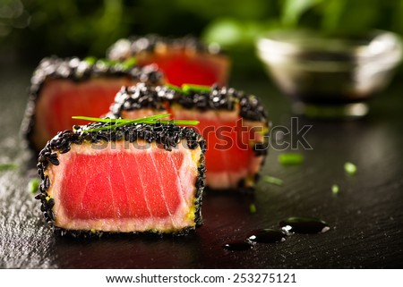 Fried tuna steak in black sesame - stock photo