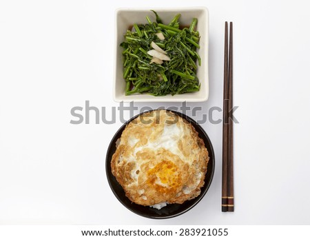 Fried vegetable and rice with crispy fried egg with space on white background - stock photo