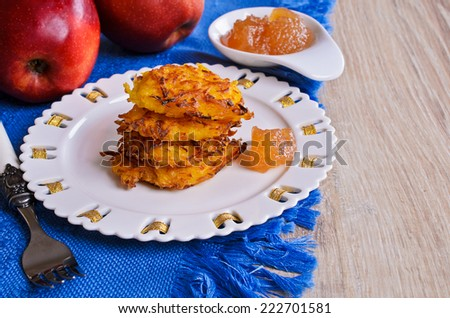 Fried vegetable cakes on a white plate - stock photo