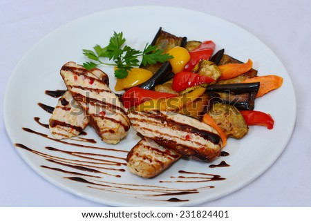 Fried vegetable salad and cheese with balsamic glaze  - stock photo