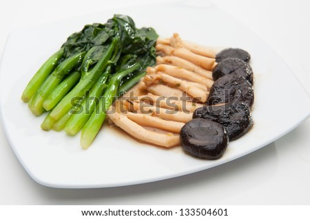 Fried Vegetables in sauce, served on white dish - stock photo