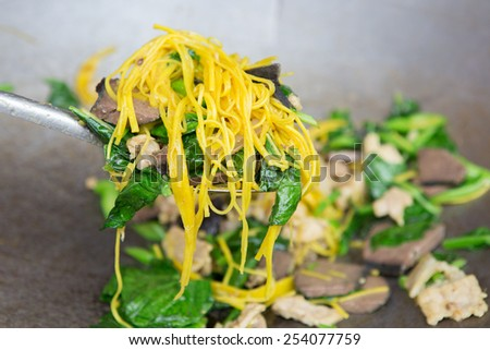 fried yellow noodle with vegetable And pork - stock photo