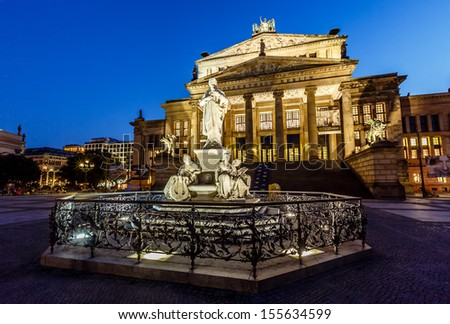 Friedrich Schiller Sculpture and Concert Hall on Gendarmenmarkt Square at Night, Berlin, Germany - stock photo