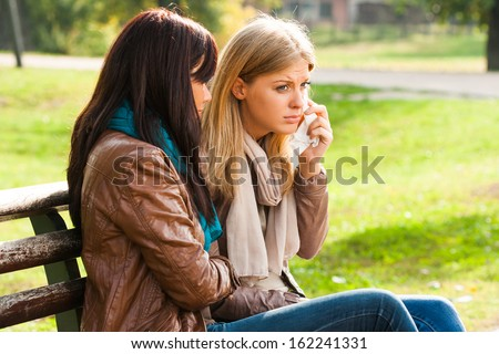 Friend comforting a crying friend,Support of friends - stock photo