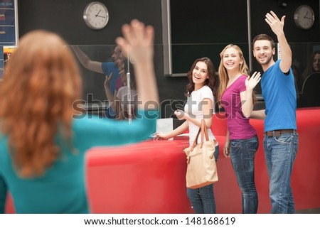Friend�¯�¿�½ meeting at the cinema. Cheerful young people greeting their friend at the cinema box office - stock photo