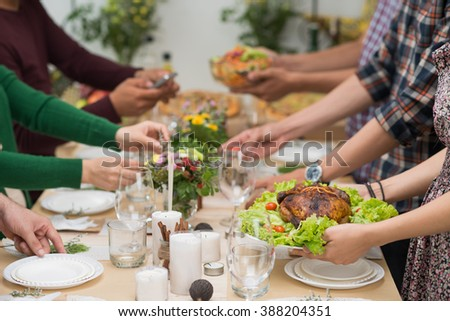 Friend or family gathered at dinner table
