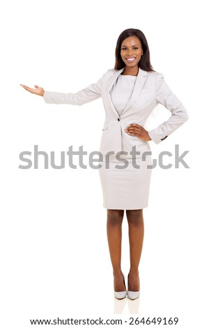 friendly african businesswoman presenting empty space - stock photo