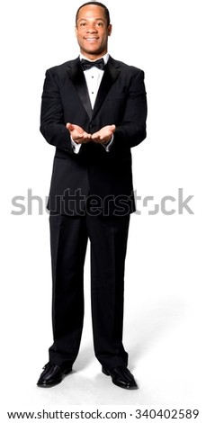 Friendly African man with short black hair in evening outfit holding invisible object - Isolated