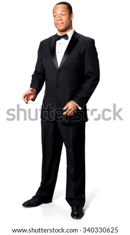 Friendly African man with short black hair in evening outfit talking with hands - Isolated