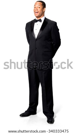 Friendly African man with short black hair in evening outfit with hands behind back - Isolated
