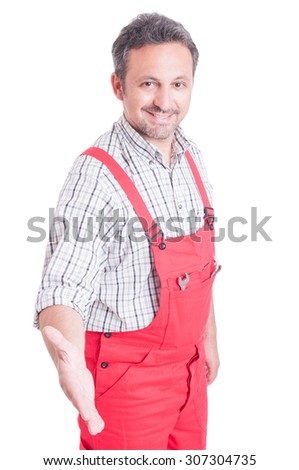 Friendly and trustworthy mechanic offering handshake isolated on white - stock photo