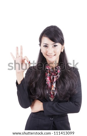 Friendly Asian Business woman giving the OK sign on white background - stock photo