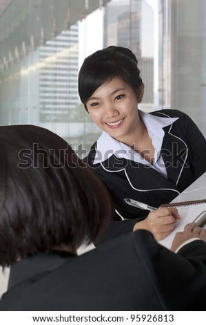 Friendly Asian businesswoman in  the office - stock photo